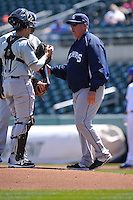 New Orleans Zephyrs pitching coach Storm Davis (48) talks to the pitcher on a trip to the mound during the game against the Iowa Cubs  at Principal Park on April 13, 2016 in Des Moines, Iowa.  The Cubs won 9-5 .  (Dennis Hubbard/Four Seam Images)