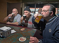 David Bruns, left, Dave Lilley, center, and Tom Ullom drink the first beers sold at Old Bag of Nails restaurant and bar in downtown Westerville, Ohio, Thursday, February 23, 2006. The business occupies a building at the main crossroads in the city that was home to the Anti-Saloon League.<br />
