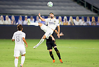 CARSON, CA - SEPTEMBER 06: Sebastian Lletget #17 of Los Angeles Galaxy jumps high for a ball during a game between Los Angeles FC and Los Angeles Galaxy at Dignity Health Sports Park on September 06, 2020 in Carson, California.