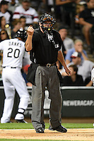Umpire Time Welke makes a call during a game between the Toronto Blue Jays and Chicago White Sox on August 15, 2014 at U.S. Cellular Field in Chicago, Illinois.  Chicago defeated Toronto 11-5.  (Mike Janes/Four Seam Images)