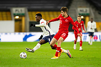 13th October 2020; Molineux Stadium, Wolverhampton, West Midlands, England; UEFA Under 21 European Championship Qualifiers, Group Three, England Under 21 versus Turkey Under 21; Eddie Nketiah of England clears as Ravil Tagir of Turkey comes in to tackle