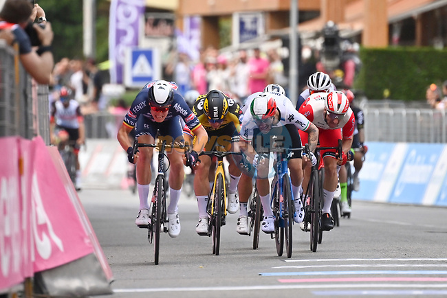 Tim Merlier (BEL) Alpecin Fenix wins the sprint ahead of Giacomo Nizzolo (ITA) Team Qhubeka Assos and Elia Viviani (ITA) Cofidis for Stage 2 of the 2021 Giro d'Italia, running 179km from Stupinigi (Nichelino) to Novara, Italy. 9th May 2021.  <br /> Picture: LaPresse/Massimo Paolone | Cyclefile<br /> <br /> All photos usage must carry mandatory copyright credit (© Cyclefile | LaPresse/Massimo Paolone)