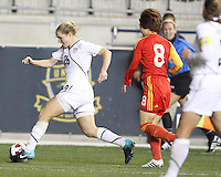Rachel Buehler #26 of the USA WNT moves past Yuan Xu #8 of the PRC WNT during an international friendly match at PPL Park, on October 6 2010 in Chester, PA. The game ended in a 1-1 tie.