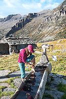 The Via Alta Verzasca is a five day ridge traverse hike above the Valle Verzasca in the Ticino region of Switzerland. Washing up in the fountain outside the Cappana Efra.