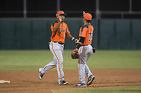 AZL Giants Orange second baseman Wascer De Leon (34) and shortstop Anyesber Sivira (32) celebrate after an Arizona League game against the AZL Athletics at Lew Wolff Training Complex on June 25, 2018 in Mesa, Arizona. AZL Giants Orange defeated the AZL Athletics 7-5. (Zachary Lucy/Four Seam Images)
