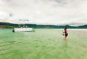 Walking with anchor in middle Kaneohe Bay.  Sand Bar Wedding in Hawaii.