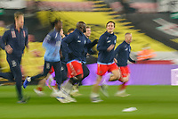 Wycombe Wanderers players warm up ahead of the Sky Bet Championship behind closed doors match between Watford and Wycombe Wanderers at Vicarage Road, Watford, England on 3 March 2021. Photo by David Horn.