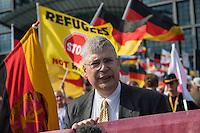 """Neonazis und Hooligans demonstrieren gegen Angela Merkel.<br /> Unter dem Motto """"Merkel muss weg"""" zogen ca. 1.200 am Samstag den 30. Juli 2016 mit einer Demonstration durch Berlin. Der Aufmarsch war vom einschlaegig bekannten Neonazi-Hooligan Enrico Stubbe angemeldet worden.<br /> Die Polizei hatte die Aufmarschroute der Rechten weitraeumig abgesperrt.<br /> Die Rechten forderten in Sprechchoeren immer wieder """"Nationalen Sozialismus! Jetzt!"""" (ein strafrechtlicher Trick, gemeint ist der Nationalsozialismus), beschimpften waehrend ihres Aufmarsches permanent Gegendemonstranten """"Wir kriegen euch alle"""" und """"Hurensoehne"""" (im Bild) und die Medienvertreter """"Luegenpresse"""". Mitarbeiter der Sicherheitsbehoerden erklaerten, dass es eindeutig ein rechtsextremer Aufmarsch gewesen sei bei dem sich keinerlei buergerliche Teilnehmer beteiligt haetten. Der Berliner Chef des Landesamt fuer Verfassungsschutz war persoenlich vor Ort um sich einen Eindruck zu verschaffen.<br /> Im Bild: Manfred Rouhs von der rechten Kleinstpartei """"Patrioten fuer Deutschland"""".<br /> 30.7.2016, Berlin<br /> Copyright: Christian-Ditsch.de<br /> [Inhaltsveraendernde Manipulation des Fotos nur nach ausdruecklicher Genehmigung des Fotografen. Vereinbarungen ueber Abtretung von Persoenlichkeitsrechten/Model Release der abgebildeten Person/Personen liegen nicht vor. NO MODEL RELEASE! Nur fuer Redaktionelle Zwecke. Don't publish without copyright Christian-Ditsch.de, Veroeffentlichung nur mit Fotografennennung, sowie gegen Honorar, MwSt. und Beleg. Konto: I N G - D i B a, IBAN DE58500105175400192269, BIC INGDDEFFXXX, Kontakt: post@christian-ditsch.de<br /> Bei der Bearbeitung der Dateiinformationen darf die Urheberkennzeichnung in den EXIF- und  IPTC-Daten nicht entfernt werden, diese sind in digitalen Medien nach §95c UrhG rechtlich geschuetzt. Der Urhebervermerk wird gemaess §13 UrhG verlangt.]"""