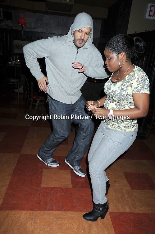 Terrell Tilford and Shenell Edmonds dancing at the Shenell Edmonds Fan Club Dance Party  on October 10, 2010 at HB Burger in New York City.