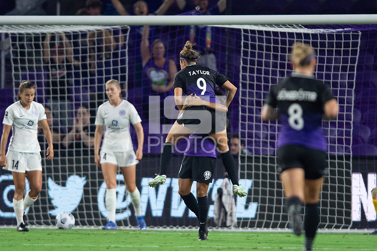 ORLANDO, FL - SEPTEMBER 11: Jodie Taylor #9 of the Orlando Pride celebrates a goal during a game between Racing Louisville FC and Orlando Pride at Exploria Stadium on September 11, 2021 in Orlando, Florida.