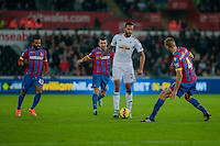 Saturday 29th November 2014<br /> Pictured: Ashley Richards of Swansea City moves the ball forwards surrounded by Palace players<br /> Re: Barclays Premier League Swansea City v Crystal Palace at the Liberty Stadium, Swansea, Wales,UK