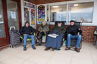 BNPS.co.uk (01202 558833)<br /> Pic: PhilYeomans/BNPS<br /> <br /> Early birds... l-r Steve Berry, Jan Ryder, Roger Learney and Matthew Cox.<br /> <br /> We will fight them for the beach huts...<br /> <br /> A group of hardy souls queued up a day early in the freezing cold to secure a sought-after beach hut for the summer.<br /> <br /> They have gone to extreme lengths to snap up the 15 timber cabins available at Avon Beach, Christchurch, Dorset.<br /> <br /> The first in the queue, Jan Ryder, was in position at 6.15am on Sunday, almost 26 hours before the administration office opened at 7.30am today.<br /> <br /> By the mid-morning, the group had already swelled to half a dozen who sat on deckchairs and sipped on tea while wrapped in blankets.<br /> <br /> Matthew Cox, 60, a mechanical engineer, was in position just before 7am. He remembers being taken to the beach by his late mother Margaret as a child and has queued up each year for a hut since her passing three years ago.