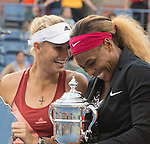 Serena Williams (USA) (black jacket) laughs with Caroline Wozniacki (DEN) after her 6-3, 6-3 victory at the US Open being played at USTA Billie Jean King National Tennis Center in Flushing, NY on September 7, 2014
