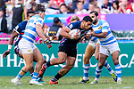 Martin Iosefo of USA (C) fights for the ball during the HSBC Hong Kong Sevens 2018 match for Plate Final between Argentina and USA on 08 April 2018, in Hong Kong, Hong Kong. Photo by Marcio Rodrigo Machado / Power Sport Images