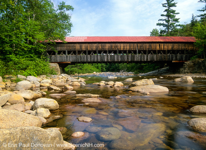 """Albany Covered Bridge which crosses the Swift River in Albany, New Hampshire, USA just off the Kancamagus Highway. This is the area of """"Blueberry Crossing"""" along the old Swift River Logging Railroad."""