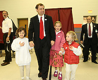 Tom Perriello, the Democratic nominee for US Representative from Virginia's 5th Congressional District, walks out of the voting booth with his nieces (from left) Caroline Rice, Allison Rice and Kelsey Perriello Tuesday Meriwether Lewis elementary school in Ivy, VA.(Photo/Andrew Shurtleff)