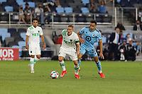 SAINT PAUL, MN - MAY 1: Danny Hoesen #9 of Austin FC and Hassani Dotson #31 of Minnesota United FC battle for the ball during a game between Austin FC and Minnesota United FC at Allianz Field on May 1, 2021 in Saint Paul, Minnesota.
