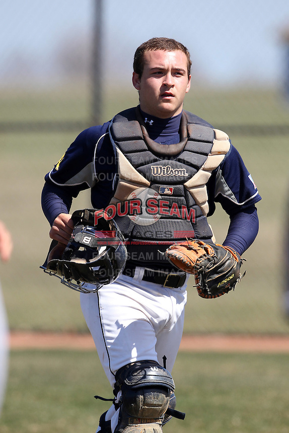 Genesee Community College Cougars catcher Adam Grace #34 during a game against the Ithaca JV team at Genesee Community College on April 9, 2011 in Batavia, New York.  Photo By Mike Janes/Four Seam Images