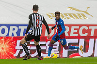 2nd February 2021; St James Park, Newcastle, Tyne and Wear, England; English Premier League Football, Newcastle United versus Crystal Palace; Wilfried Zaha of Crystal Palace shadowed by Ciaran Clark of Newcastle United