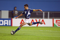 Claudio Reyna boots the ball upfield. The USA lost 3-1 against Poland in the FIFA World Cup 2002 in Korea on June 14, 2002.
