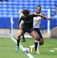 Oldham Athletic's Sido Jombati shields the ball from Bolton Wanderers' Nathan Delfouneso<br /> <br /> Photographer Stephen White/CameraSport<br /> <br /> The EFL Sky Bet League Two - Bolton Wanderers v Oldham Athletic - Saturday 17th October 2020 - University of Bolton Stadium - Bolton<br /> <br /> World Copyright © 2020 CameraSport. All rights reserved. 43 Linden Ave. Countesthorpe. Leicester. England. LE8 5PG - Tel: +44 (0) 116 277 4147 - admin@camerasport.com - www.camerasport.com