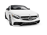 White 2015 Mercedes Benz S63 AMG Coupe luxury car isolated on white background with a clipping path Image © MaximImages, License at https://www.maximimages.com