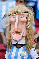 An Argentina fan with a model head