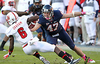 Oct. 22, 2011 - Charlottesville, Virginia - USA; Virginia Cavaliers defensive end Bill Schautz (47) goes after North Carolina State wide receiver T.J. Graham (6) during an NCAA football game at the Scott Stadium. NC State defeated Virginia 28-14. (Credit Image: © Andrew Shurtlef