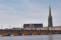 The old bridge Pont de Pierre. Tower and church Eglise Saint Michel. Bordeaux city, Aquitaine, Gironde, France
