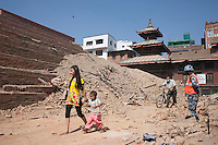 A Nepali girl walks through the rubble of a destroyed temple at Kathmandu Durbar Square, Kathmandu, Nepal. May 03, 2015