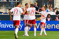 Heath Pearce (3) of the New York Red Bulls celebrates scoring with teammates. The New York Red Bulls defeated the Philadelphia Union 3-0 during a Major League Soccer (MLS) match at PPL Park in Chester, PA, on October 27, 2012.