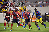 Brek Shea (11), Jozy Altidore (9), Carlos Bocanegra (5) of the United States and Segundo Castillo (14) of Ecuador track the ball on a set piece. The men's national team of the United States (USA) was defeated by Ecuador (ECU) 1-0 during an international friendly at Red Bull Arena in Harrison, NJ, on October 11, 2011.