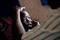 Africa, Sudan, Magwi County, Nimule, Southern Sudan -Orphan Paul undergoes a health check at Merlin Hospital in Nimule to make sure he is in good health. Paul's parents were both murdered by the Lord's Resistance Army leaving him as an orphan. December 2005 © Stephen Blake Farrington