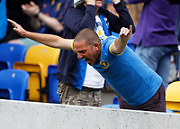 4th September 2021; Merton, London, England;  EFL Championship football, AFC Wimbledon versus Oxford City: A delighted AFC Wimbledon fan cheering after full time as AFC Wimbledon win their fist home match of the season inside Plough Lane with the return of fans