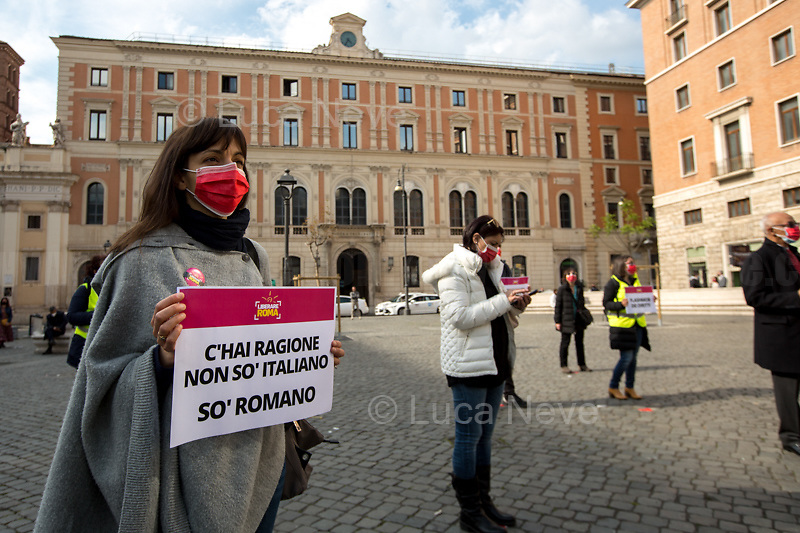 """Rome, Italy. 21st Apr, 2021. Today, Liberare Roma and NiBi (Neri Italiani - Black Italians) held a flash-mob in Piazza San Silvestro (1.) to call the Italian Government led by Mario Draghi (Government supported by all the Italian Parties except the right wing Party Fratelli d'Italia) 2.) to finally make the long awaited reform of the citizenship law which will give the Italian Citizenship to the children who are born and grown up in Italy once called """"Ius Soli"""" or """"Ius Culturae"""" Law. <br /> «I was born here in Italy, I grew up here, I live here, I study here, I love here, I live and plan my future here. However, I do not have the same rights of all the other Italians» (1.).<br /> <br /> Footnotes and Links:<br /> 1. http://bit.do/fQy7U <br /> 2. http://bit.do/fQy9F  <br /> Previous Demos: <br /> - First Conte's Government (Centre-Right) http://bit.do/fi83r <br /> - Second Conte's Government (Centre-Left) http://bit.do/fJ2pc<br /> - Second Conte's Government (Centre-Left) http://bit.do/fQy9F"""