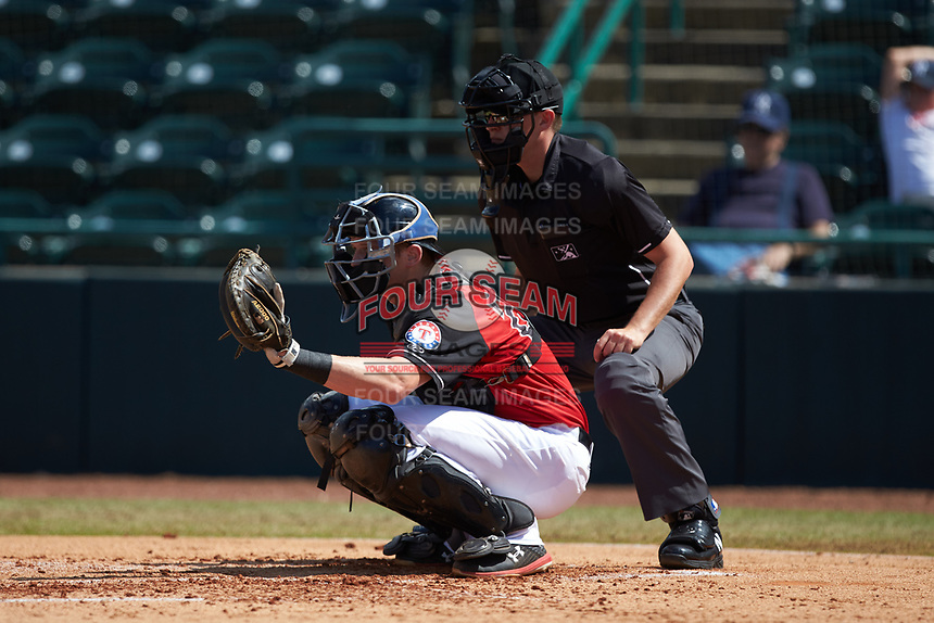Hickory Crawdads catcher Sam Huff (24) sets a target as home plate umpire Sean Cassidy looks on during the game against the Lakewood BlueClaws at L.P. Frans Stadium on April 28, 2019 in Hickory, North Carolina. The Crawdads defeated the BlueClaws 10-3. (Brian Westerholt/Four Seam Images)