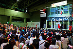 """People look at the singers at the Niconico Douga fan event at Makuhari Messe International Exhibition Hall on April 25, 2015, Chiba, Japan. The event includes special attractions such as J-pop concerts, Sumo and Pro Wrestling matches, cosplay and manga and various robot performances and is broadcast live on via the video-sharing site. Niconico Douga (in English """"Smiley, Smiley Video"""") is one of Japan's biggest video community sites where users can upload, view, share videos and write comments directly in real time, creating a sense of a shared watching. According to the organizers more than 200,000 viewers for two days will see the event by internet. The popular event is held in all 11 halls of the huge Makuhari Messe exhibition center from April 25 to 26. (Photo by Rodrigo Reyes Marin/AFLO)"""