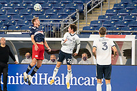 FOXBOROUGH, MA - OCTOBER 19: Henry Kessler #4 of New England Revolution heads the ball during a game between Philadelphia Union and New England Revolution at Gillette on October 19, 2020 in Foxborough, Massachusetts.