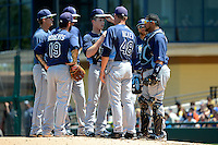 Tampa Bay Rays pitching coach Jim Hickey #48 talks with pitcher Jeremy Hellickson #58 (center) as Ryan Roberts #19, Jake Hager #21, Ben Zobrist #18, James Loney #21, and Jose Molina #28 listen in during a Spring Training game against the Detroit Tigers at Joker Marchant Stadium on March 29, 2013 in Lakeland, Florida.  (Mike Janes/Four Seam Images)