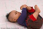 6 month old baby boy on back grabbing foot full length horizontal