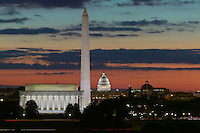 The Lincoln Memorial, Washington Monument, and US Capitol building during morning twilight as seen from Arlington, Virginia