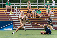 NEWTON, MA - MAY 22: Belle Smith #5 of Boston College continues drive to net as fallen Diana Kelly #12 of Notre Dame attempts to defend during NCAA Division I Women's Lacrosse Tournament quarterfinal round game between Notre Dame and Boston College at Newton Campus Lacrosse Field on May 22, 2021 in Newton, Massachusetts.