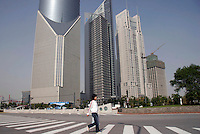 Pedestrians walking in the Pudong Financial District of Shanghai, China. One of China's policy banks, the China Development Bank, has plans to grant 30 billion RMB (Euro 3 Billion) in loans to Pudong as a part of the country's 11th Five-Year Programme. .07 Nov 2005