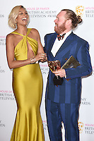 Leigh Francis and Alesha Dixon<br /> in the winners room at the 2016 BAFTA TV Awards, Royal Festival Hall, London<br /> <br /> <br /> ©Ash Knotek  D3115 8/05/2016