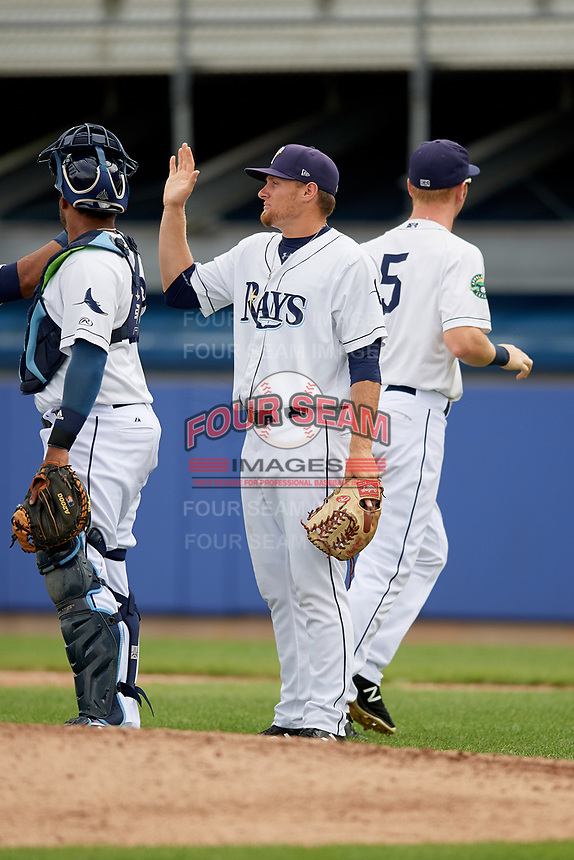 Princeton Rays relief pitcher Heath Renz (37) celebrates with his teammates after the first game of a doubleheader against the Greeneville Reds on July 25, 2018 at Hunnicutt Field in Princeton, West Virginia.  Princeton defeated Greeneville 6-4.  (Mike Janes/Four Seam Images)