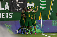 Portland, Oregon - Wednesday September 25, 2019: The Portland Timbers celebrates scoring a goal during a regular season game between Portland Timbers and New England Revolution at Providence Park on September 25, 2019 in Portland, Oregon.