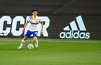 LOS ANGELES, CA - SEPTEMBER 02: Cristian Espinoza #10 of the San Jose Earthquakes moves with the ball looking for an open man during a game between San Jose Earthquakes and Los Angeles FC at Banc of California stadium on September 02, 2020 in Los Angeles, California.