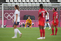 KASHIMA, JAPAN - AUGUST 2: Alyssa Naeher #1 of the United States takes a knee after an injury during a game between Canada and USWNT at Kashima Soccer Stadium on August 2, 2021 in Kashima, Japan.