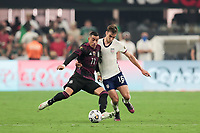 LAS VEGAS, NV - AUGUST 1: Rogelio Funes Mori #11 of Mexico battles for the ball with James Sands #16 of the United States during a game between Mexico and USMNT at Allegiant Stadium on August 1, 2021 in Las Vegas, Nevada.