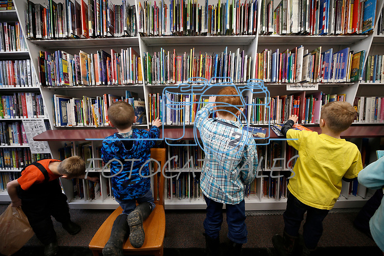 Students select their books from the Elko County Bookmobile during a recent visit to the one-room schoolhouse in Ruby Valley. <br />Photo by Cathleen Allison/Nevada Momentum